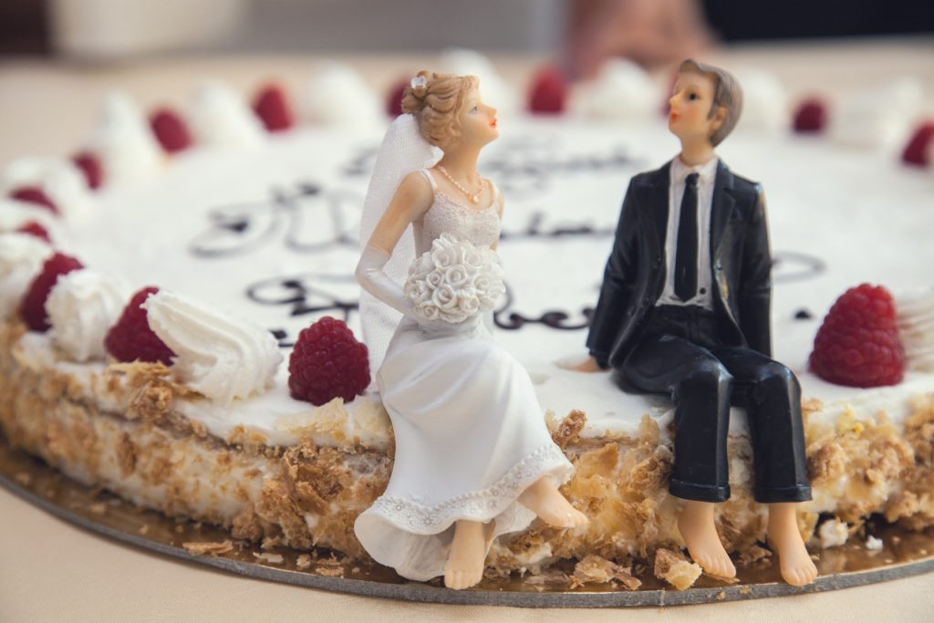 Couple on cake for happy marriage